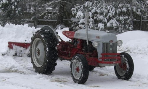 [Photo of my other tractor plowing snow]